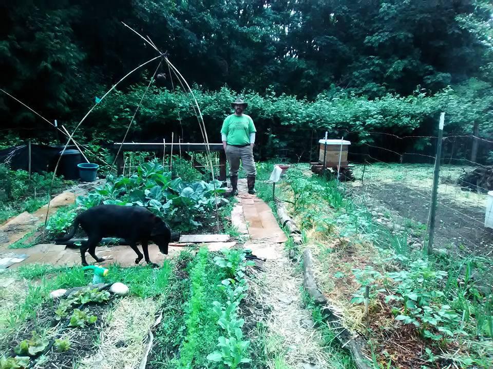 Jason-compost-everything-shirt-in-garden-web