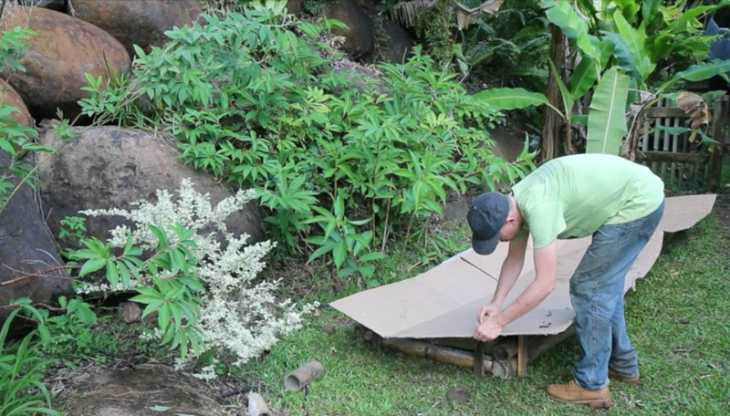 lasagna-gardening-cutting-cardboard-weedblock-layer